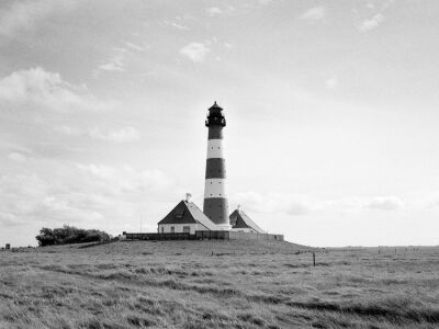 Monochrome series from Westerhever at the North See. Salt meadows and lighthouse,Westerhever, Germany   Photographed by Alexandre Miguel Maia